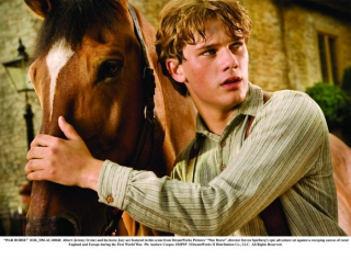 """""""WAR HORSE"""" 032b_DM-AC-00040 Albert (Jeremy Irvine) and his horse Joey are featured in this scene from DreamWorks Pictures' """"War Horse"""", director Steven Spielberg's epic adventure set against a sweeping canvas of rural England and Europe during the First World War. Ph: Andrew Cooper, SMPSP ©DreamWorks II Distribution Co., LLC. All Rights Reserved."""