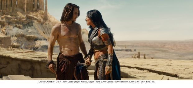 """JOHN CARTER""L to R: John Carter (Taylor Kitsch), Dejah Thoris (Lynn Collins)©2011 Disney. JOHN CARTER™ ERB, Inc."